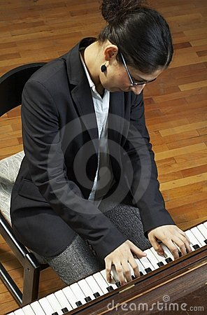 Teacher Playing Piano Keyboard