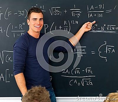 Teacher pointing at blackboard teaching math
