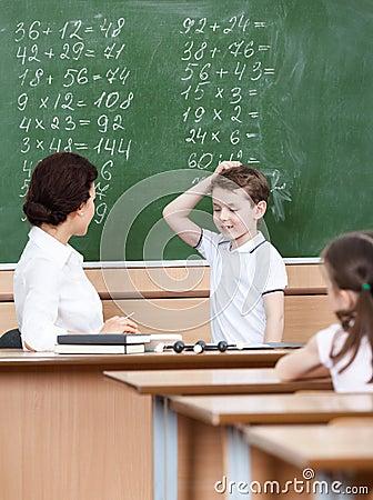 Teacher questions the pupil