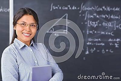 Teacher or Scholar  pose in front of blackboard