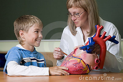 Teacher and schoolboy with heart