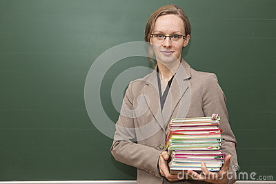 Teacher with stack of books