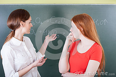 Teacher and student on chemistry lesson