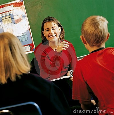 Teacher With Students In A Classroom
