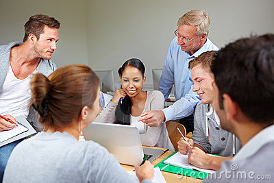 Teacher with students in college
