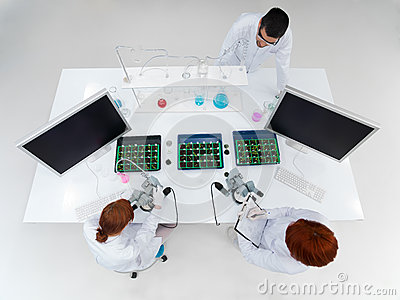 Teacher and students in a laboratory