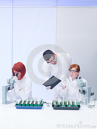 Teacher supervising lab experiments