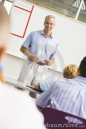 A teacher talks to school children in a classroom