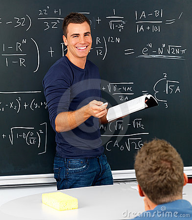 Teacher teaching mathematics in classroom