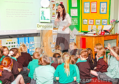 Teacher teaching primary schoolchildren Editorial Stock Photo