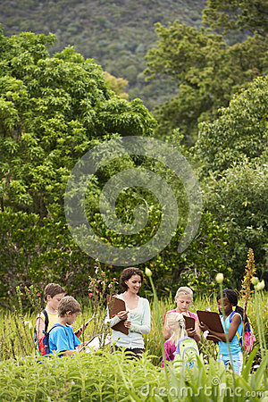 Free Teacher With Children Preparing Notes During Field Trip Stock Photo - 33911790
