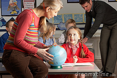 Teachers Giving Geography Lesson To Children