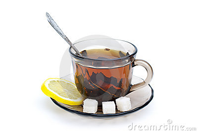 Teacup, lemon slice and some sugar pieces
