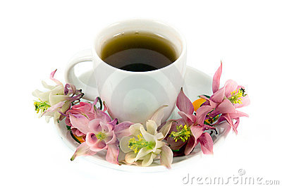 Teacup With Tea And Flowers Stock Photo - Image: 5618700