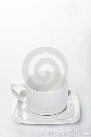 Teacup on white tablecloth