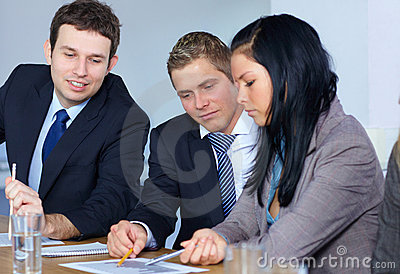 Team of 3 business people work on some paperwork