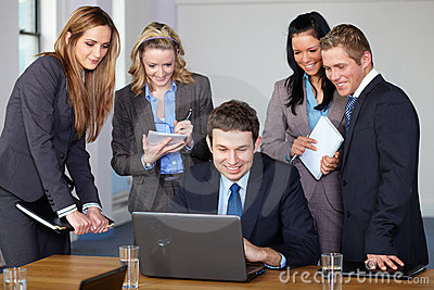 Team of 5 business people during meeting