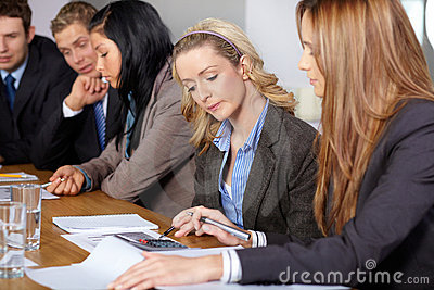 Team of 5 business people working on calculations