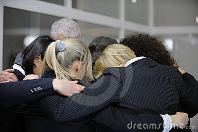 Team building event: group hug in office