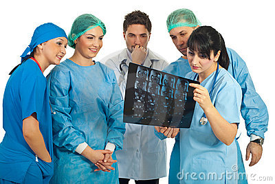 Team of doctors examine MRI