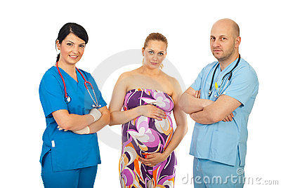 Team of doctors and pregnant woman