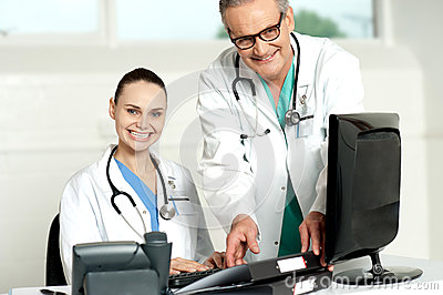 Team of doctors working on computer