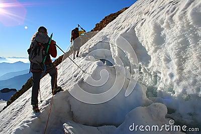 team doing a dangerous climbing