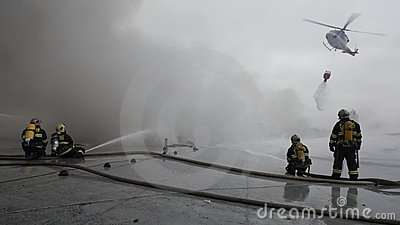 The team of firemen fighting with the fire Editorial Image