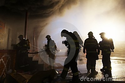 The team of firemen fighting with the fire