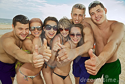 Team of friends having fun at the beach