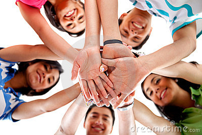 Team with hands together