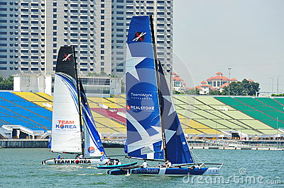 Team Korea racing Realteam at the Extreme Sailing Series Singapore 2013 Editorial Photography