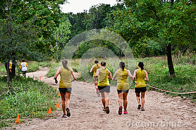 Team of mud race participants on the course Editorial Image