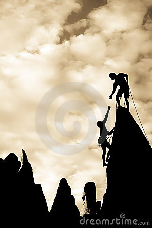 Free Team Of Climbers On The Summit. Stock Images - 8316754