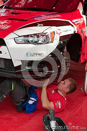 Team riders prepares car to Prime Yalta Rally Editorial Photo
