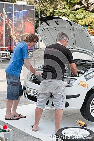Team riders prepares car to Prime Yalta Rally Editorial Image