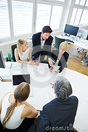 Team talking in business meeting at conference table