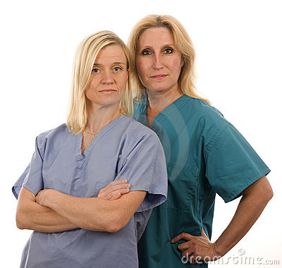 Team of two nurses in medical scrubs clothes