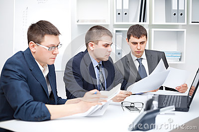 Team of young business men doing some paperwork