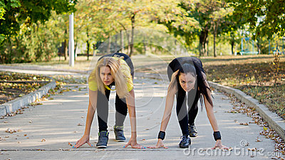 Teammates training for a running competition