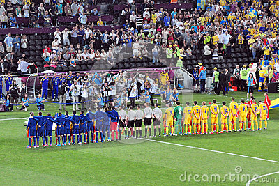 Teams of France and the Ukraine listening anthems Editorial Image