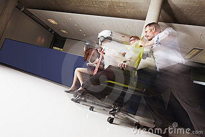 Teams in office chair race.