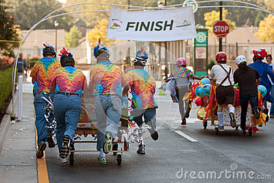 Teams Push Beds Toward Finish Of Mattress Race Editorial Image