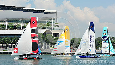Teams racing at Extreme Sailing Series Singapore 2013 Editorial Stock Image
