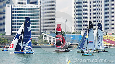 Teams racing at the Extreme Sailing Series Singapore 2013 Editorial Photography