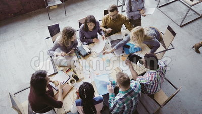 Teamwork in boardroom at modern office. Female team leader giving direction to multiethnic group of people. Top view. Teamwork in boardroom at modern trendy stock video