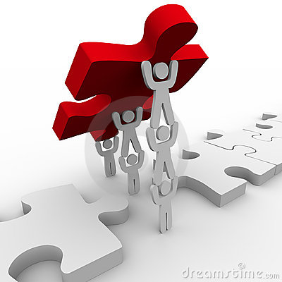 Free Teamwork Placing Final Piece In Puzzle Stock Photo - 13220490
