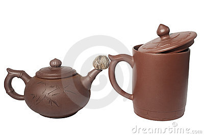 Teapot, cup and rolled dry teaball