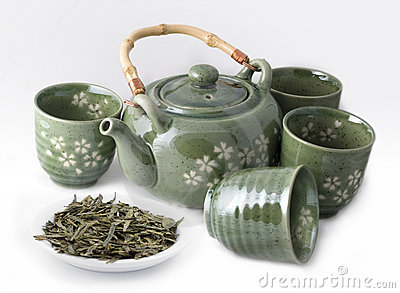 Teapot with Cups and Green Tea