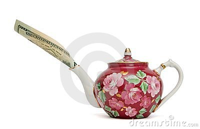 Teapot with dollar bill sticking out of spout
